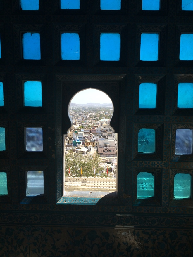 Blue stained glass window over Udaipur